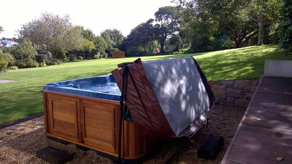Opened Arctic Spas Hot tub in the backyard