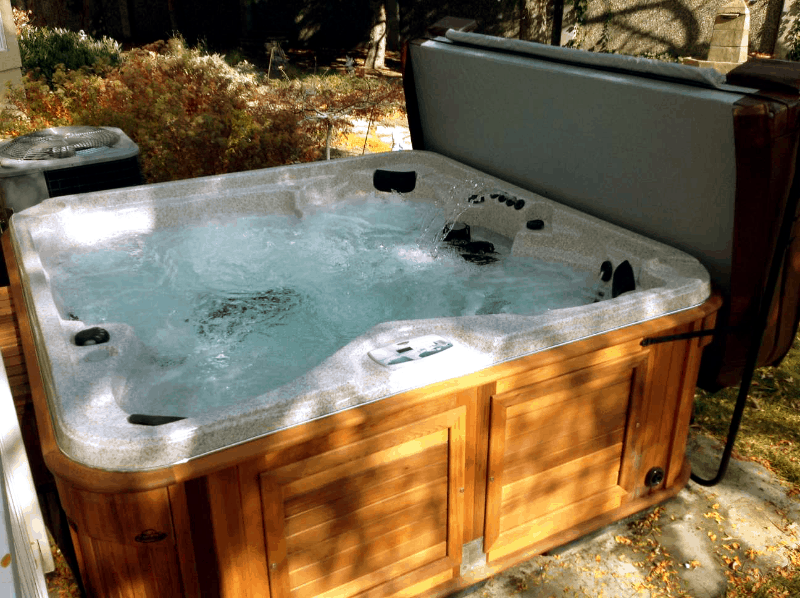 Arctic Spas Hot tub with an open cover